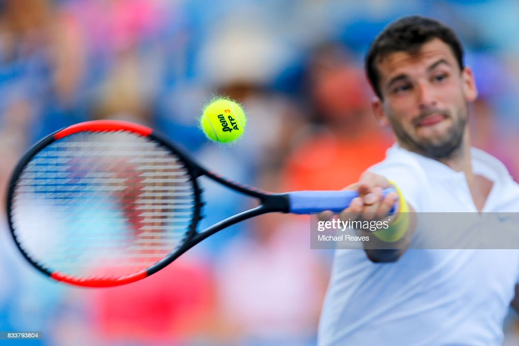 Grigor Dimitrov of Bulgaria returns a shot to Juan Martin Del Potro of Argentina during Day 6 of the Western and Southern Open at the Lindner Family Tennis Center on August 17, 2017 in Mason, Ohio.