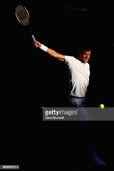 Grigor Dimitrov of Bulgaria returns against Stanislas Wawrinka of Switzerland during their Men's Singles first round match on day one of the...