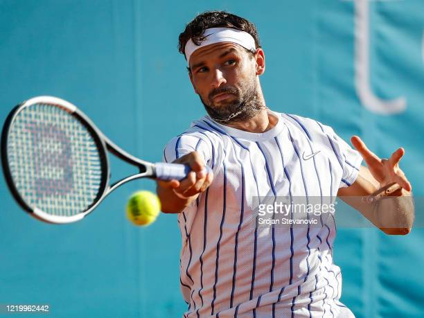 Grigor Dimitrov of Bulgaria returns the ball against Dominic Thiem of Austria during the Adria Tour charity exhibition hosted by Novak Djokovic on...