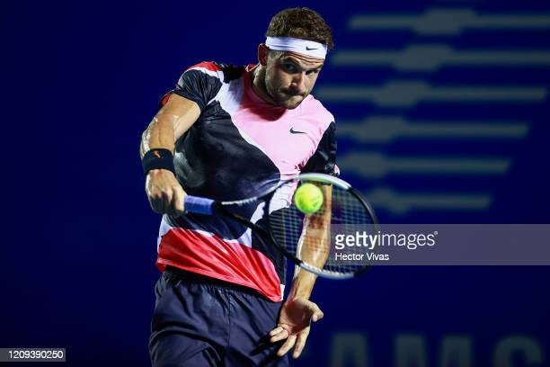 Grigor Dimitrov of Bulgaria returns the ball during the singles match between Rafael Nadal of Spain and Grigor Dimitrov of Bulgaria as part of the...