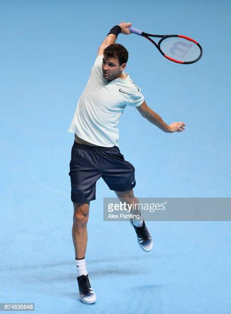 Grigor Dimitrov of Bulgaria returns the ball during the singles match against David Goffin of Belgium on day four of the 2017 Nitto ATP World Tour...