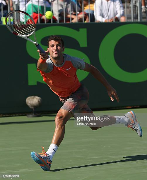 Grigor Dimitrov of Bulgaria runs to play a forehand against Albert Montanes of Spain during their second round match during day 5 at the Sony Open at...