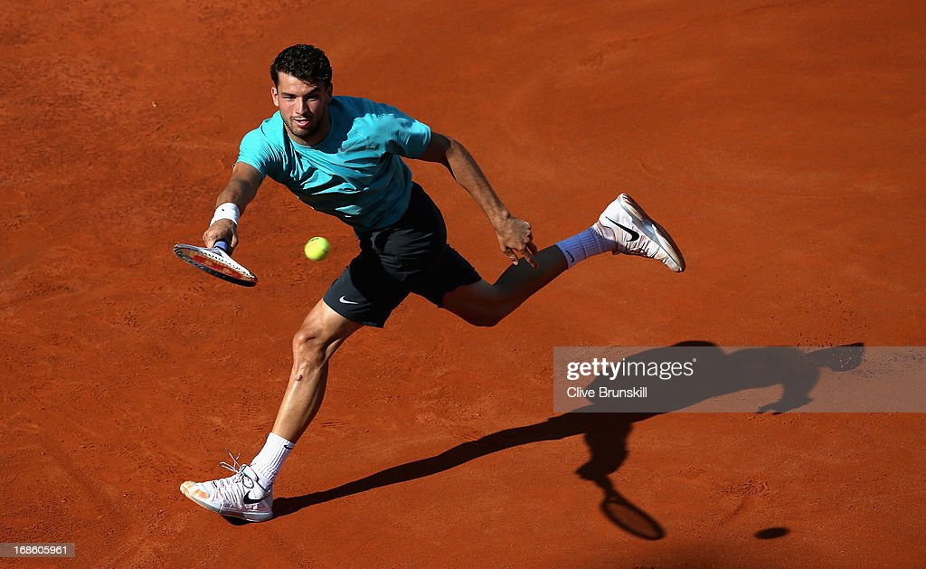 Grigor Dimitrov of Bulgaria runs to play a forehand against Marcos Baghdatis of Cyprus in their first round match during day one of the Internazionali BNL d'Italia 2013 at the Foro Italico Tennis Centre on May 12, 2013 in Rome, Italy.