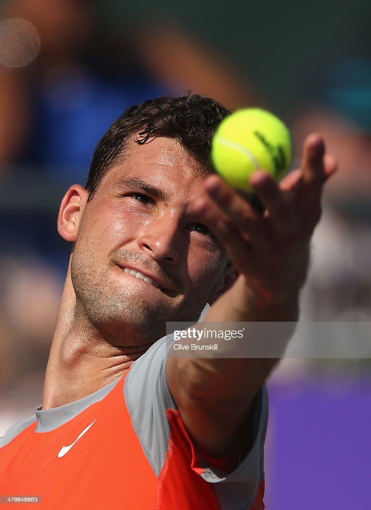 Grigor Dimitrov of Bulgaria serves against Albert Montanes of Spain during their second round match during day 5 at the Sony Open at Crandon Park Tennis Center on March 21, 2014 in Key Biscayne, Florida.