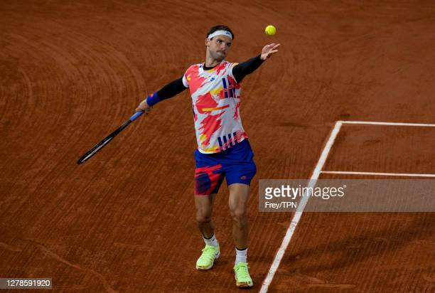 Grigor Dimitrov of Bulgaria serves against Stefanos Tsitsipas of Greece in the fourth round of the men's singles at Roland Garros on October 05 2020...