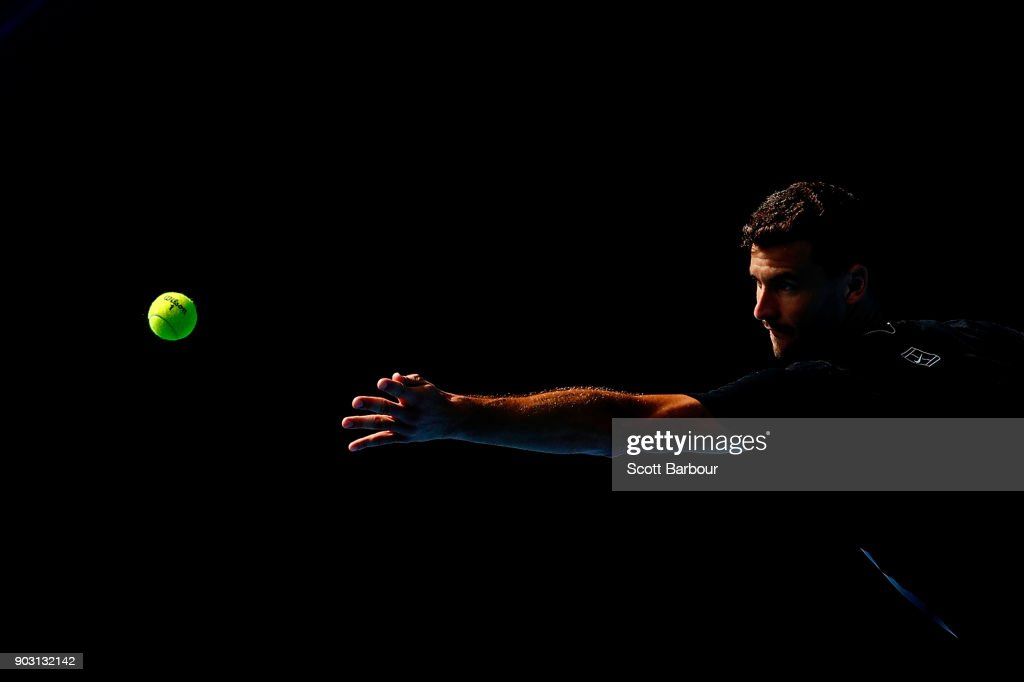Grigor Dimitrov of Bulgaria serves during a practice session ahead of the 2018 Australian Open at Melbourne Park on January 10, 2018 in Melbourne, Australia.