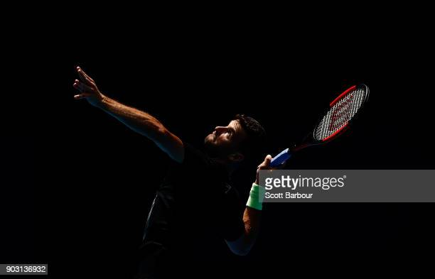 Grigor Dimitrov of Bulgaria serves during a practice session ahead of the 2018 Australian Open at Melbourne Park on January 10 2018 in Melbourne...