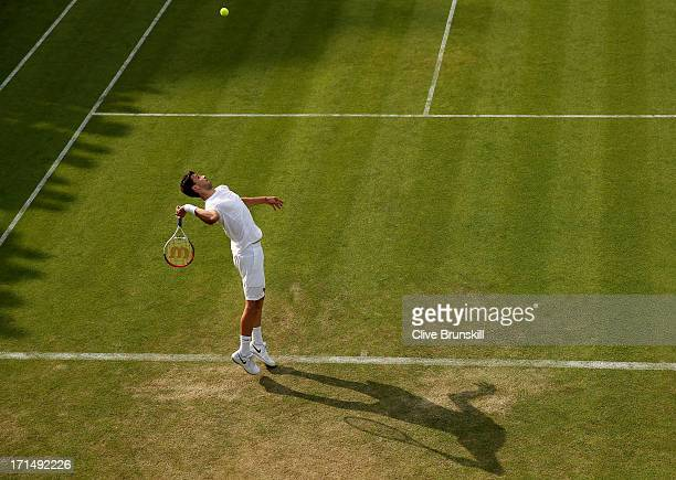 Grigor Dimitrov of Bulgaria serves during his Gentlemen's Singles first round match against Simone Bolelli of Italy on day two of the Wimbledon Lawn...