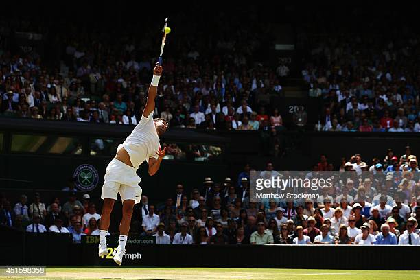 Grigor Dimitrov of Bulgaria serves during his Gentlemen's Singles quarterfinal match against Andy Murray of Great Britain on day nine of the...