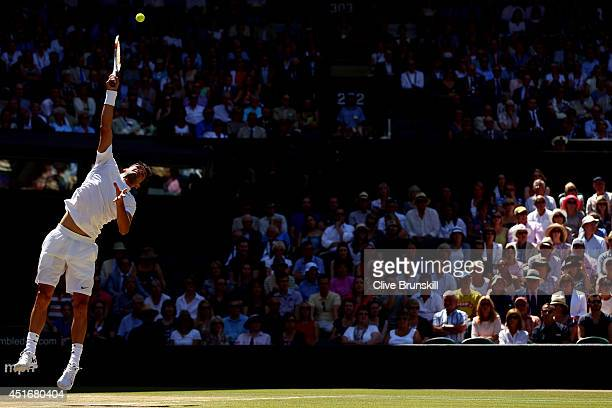 Grigor Dimitrov of Bulgaria serves during his Gentlemen's Singles semifinal match against Novak Djokovic of Serbia on day eleven of the Wimbledon...