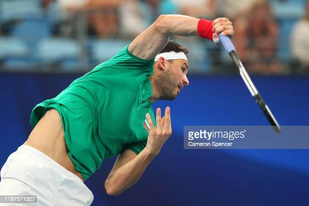 Grigor Dimitrov of Bulgaria serves during his Group C singles match against Radu Albot of Moldova during day three of the 2020 ATP Cup Group Stage at...