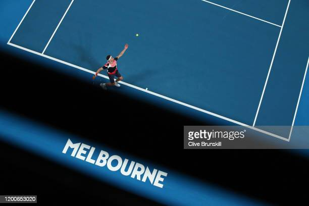 Grigor Dimitrov of Bulgaria serves during his Men's Singles first round match against Juan Ignacio Londero of Argentina on day one of the 2020...