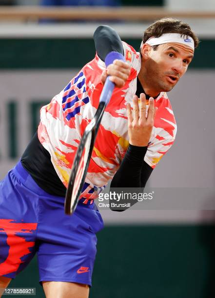Grigor Dimitrov of Bulgaria serves during his Men's Singles fourth round match against Stefanos Tsitsipas of Greece on day nine of the 2020 French...