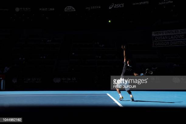 TOPSHOT Grigor Dimitrov of Bulgaria serves during his men's singles second round match against Serbia's Dusan Lajovic at the China Open tennis...