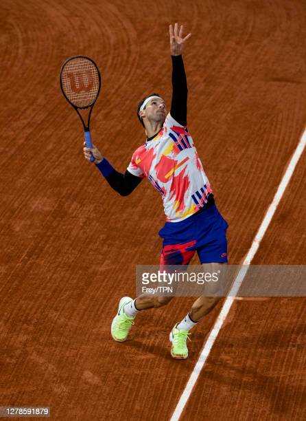 Grigor Dimitrov of Bulgaria serves in advance of his wedding against Stefanos Tsitsipas of Greece in the fourth round of the men's singles at Roland...