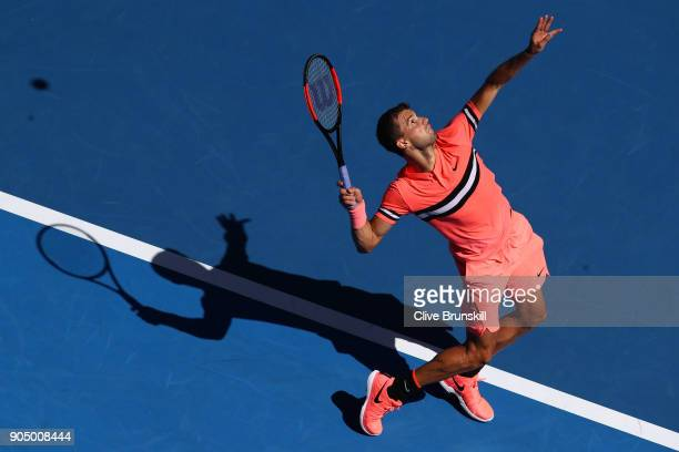 Grigor Dimitrov of Bulgaria serves in his first round match against Dennis Novak of Austria on day one of the 2018 Australian Open at Melbourne Park...