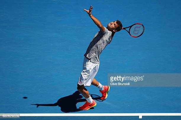 Grigor Dimitrov of Bulgaria serves in his quarterfinal match against David Goffin of Belgium on day 10 of the 2017 Australian Open at Melbourne Park...