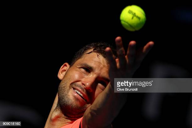 Grigor Dimitrov of Bulgaria serves in his quarterfinal match against Kyle Edmund of Great Britain on day nine of the 2018 Australian Open at...