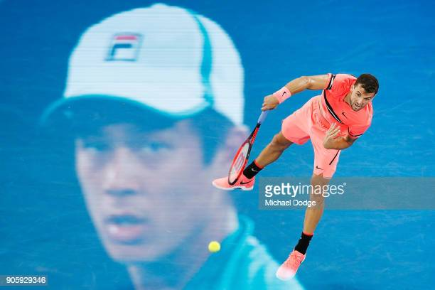 Grigor Dimitrov of Bulgaria serves in his second round match against Mackenzie McDonald of the United States on day three of the 2018 Australian Open...