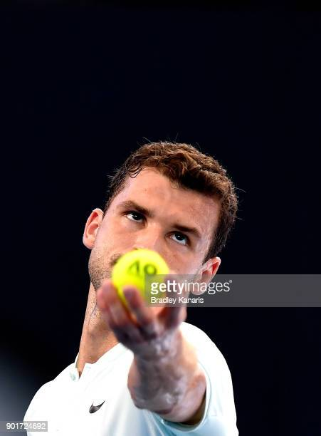 Grigor Dimitrov of Bulgaria serves in his semi final match against Nick Kyrgios of Australia during day seven of the 2018 Brisbane International at...