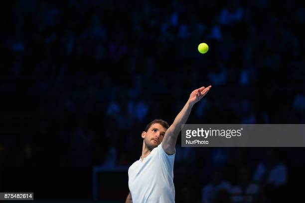 Grigor Dimitrov of Bulgaria serves in his Singles match against Pablo Carreno Busta of Spain during day six of the Nitto ATP World Tour Finals at O2...