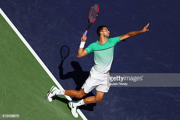 Grigor Dimitrov of Bulgaria serves to Alexander Zverev of Germany during day seven of the BNP Paribas Open at Indian Wells Tennis Garden on March 13...