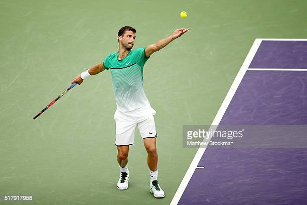 Grigor Dimitrov of Bulgaria serves to Andy Murray of Great Britain during the Miami Open presented by Itau at Crandon Park Tennis Center on March 28...