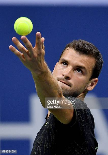 Grigor Dimitrov of Bulgaria serves to Andy Murray of Great Britain during his fourth round Men's Singles match on Day Eight of the 2016 US Open at...
