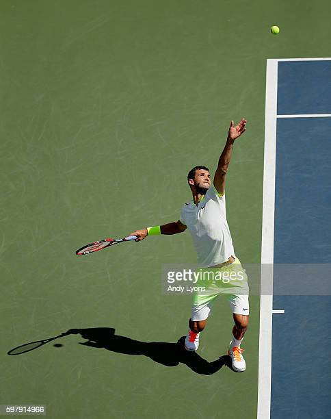 Grigor Dimitrov of Bulgaria serves to Inigo Cervantes of Spain during his first round Men's Singles match on Day Two of the 2016 US Open at the USTA...