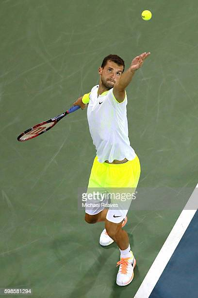 Grigor Dimitrov of Bulgaria serves to Jeremy Chardy of France during his second round Men's Singles match on Day Four of the 2016 US Open at the USTA...