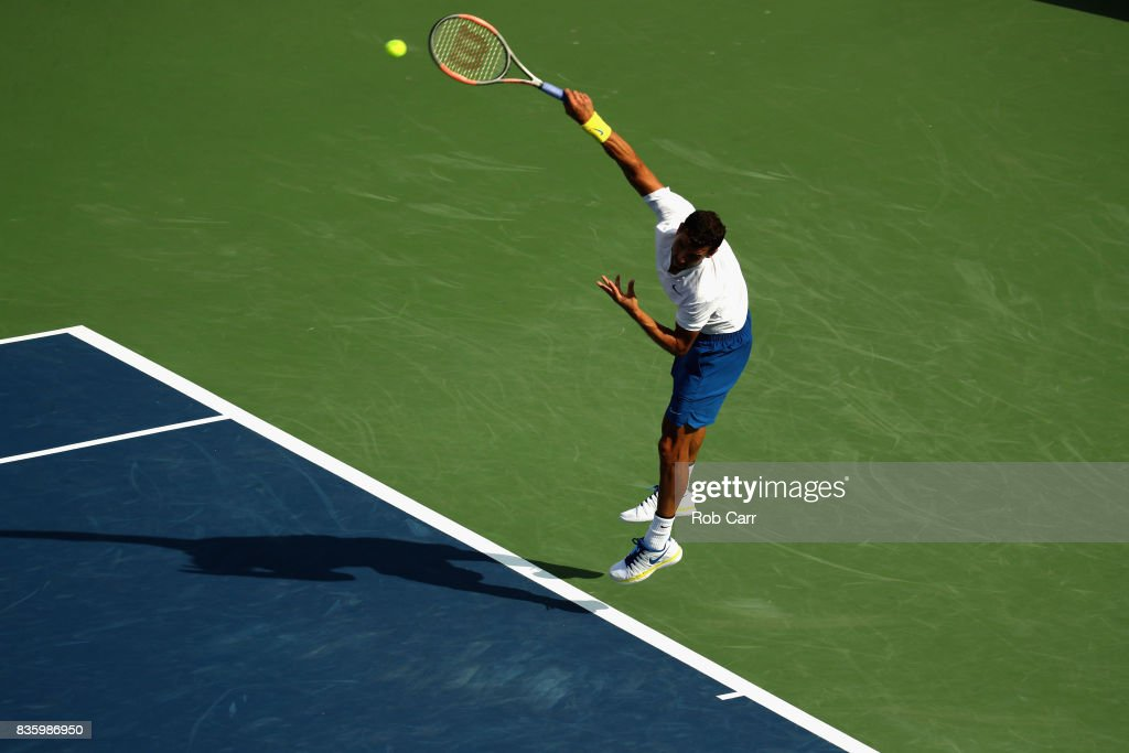 Grigor Dimitrov of Bulgaria serves to Nick Kyrgios of Australia during the men's final during Day 9 of of the Western and Southern Open at the Linder Family Tennis Center on August 20, 2017 in Mason, Ohio.