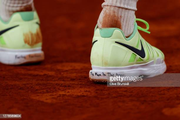 Grigor Dimitrov of Bulgaria shoes are seen with writing on both heels during his Men's Singles fourth round match against Stefanos Tsitsipas of...