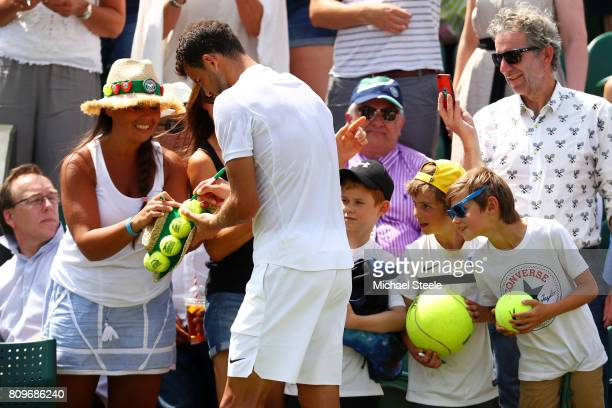Grigor Dimitrov of Bulgaria signs autographs after his during the Gentlemen's Singles second round match against Marcos Baghadatis of Cyprus on day...