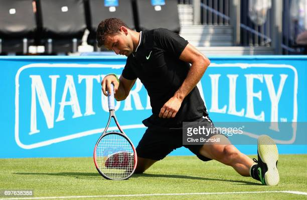 Grigor Dimitrov of Bulgaria slips during the mens singles first round match against Ryan Harrison of The United States during day one of the 2017...