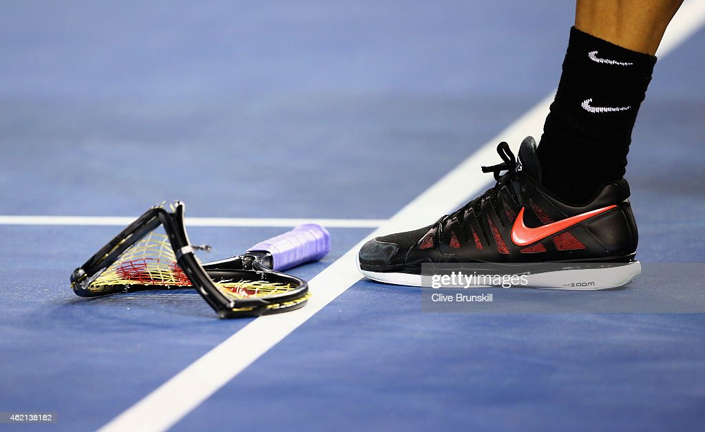 Grigor Dimitrov of Bulgaria smashes his racket in his fourth round match against Andy Murray of Great Britain during day seven of the 2015 Australian Open at Melbourne Park on January 25, 2015 in Melbourne, Australia.