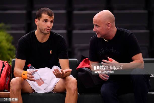 Grigor Dimitrov of Bulgaria speaks with coach Andre Agassi during practice ahead of the Rolex Paris Masters on October 28 2018 in Paris France