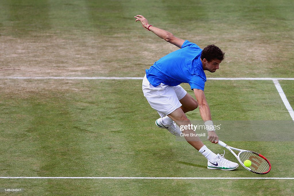 Grigor Dimitrov of Bulgaria stretches for a backhand return during his mens singles semi-final match against David Nalbandian of Argentina on day six of the AEGON Championships at Queens Club on June 16, 2012 in London, England.