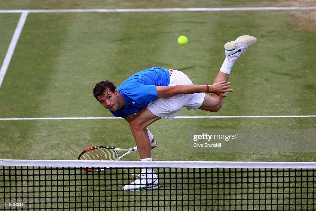 Grigor Dimitrov of Bulgaria stretches for a forehand return during his mens singles semi-final match against David Nalbandian of Argentina on day six of the AEGON Championships at Queens Club on June 16, 2012 in London, England.