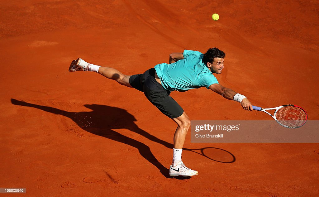 Grigor Dimitrov of Bulgaria stretches to play a backhand against Marcos Baghdatis of Cyprus in their first round match during day one of the Internazionali BNL d'Italia 2013 at the Foro Italico Tennis Centre on May 12, 2013 in Rome, Italy.