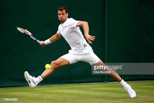 Grigor Dimitrov of Bulgaria stretches to play a forehand in his Men's Singles first round match against Corentin Moutet of France during Day one of...