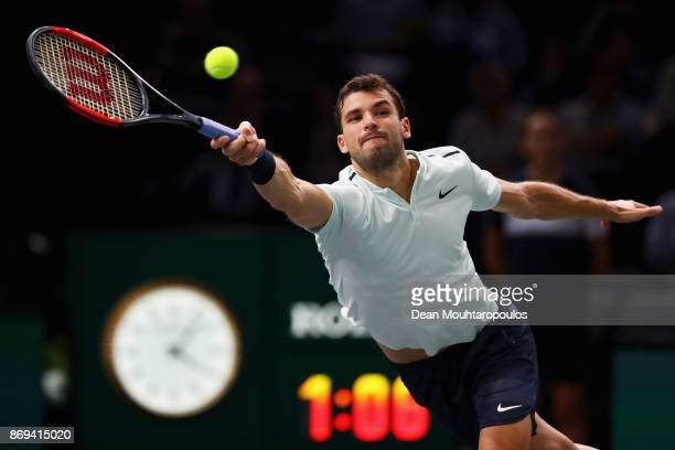 Grigor Dimitrov of Bulgaria stretches to play the forehand against John Isner of the USA during Day 4 of the Rolex Paris Masters held at the...
