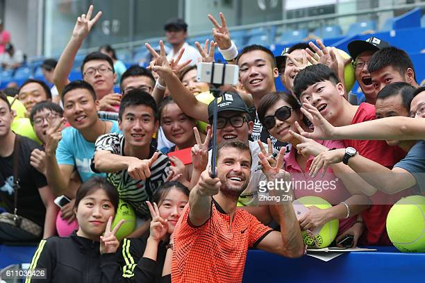 Grigor Dimitrov of Bulgaria takes selfie with fans after winning the match against Dusan Lajovic of Serbia during Day 3 of 2016 ATP Chengdu Open at...