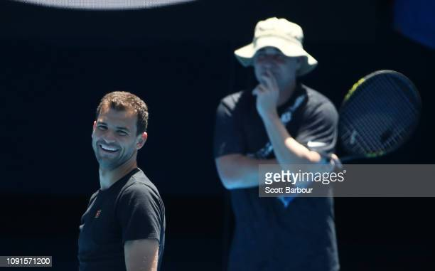 Grigor Dimitrov of Bulgaria talks with his coach Andre Agassi during a practice session ahead of the 2019 Australian Open at Melbourne Park on...