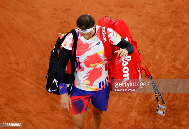 Grigor Dimitrov of Bulgaria walks off the court following defeat in his Men's Singles fourth round match against Stefanos Tsitsipas of Greece on day...
