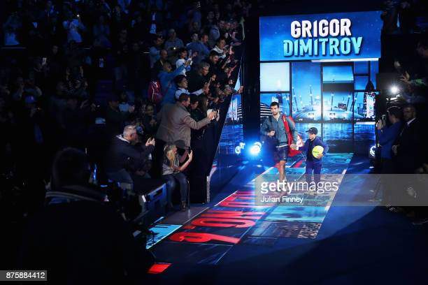 Grigor Dimitrov of Bulgaria walks out for his Singles Semi Final match against Jack Sock of the United States during day seven of the Nitto ATP World...