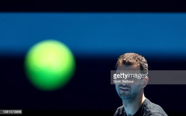 Grigor Dimitrov of Bulgaria watches the ball during a practice session ahead of the 2019 Australian Open at Melbourne Park on January 09, 2019 in...