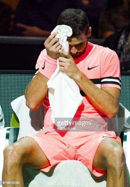 Grigor Dimitrov of Bulgaria wipes his face with a towel during a break in his men's singles final against Roger Federer of Switzerland for the ABN...