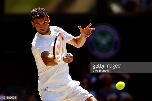 Grigor Dimitrov of during his Gentlemen's Singles semifinal match against Novak Djokovic of Serbia on day eleven of the Wimbledon Lawn Tennis...