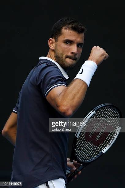Grigor Dimitrov of of Bulgaria celebrates against Tennys Sandgren of The United States during their Men's Singles 1nd Round match of the 2018 China...