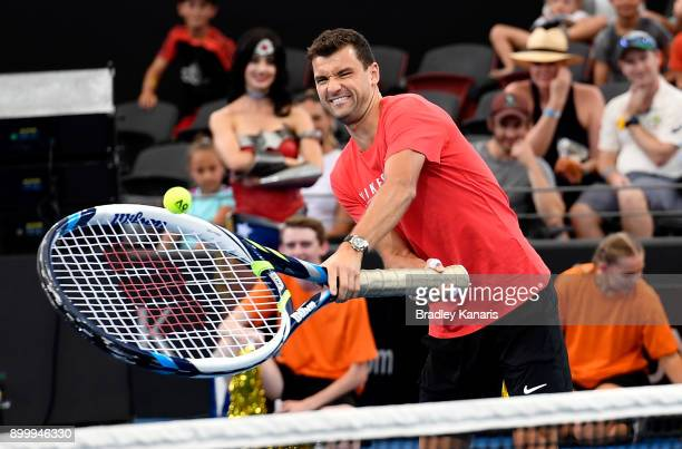 Grigor Dimitrov plays a shot with a giant tennis racquet during Kids Day at the 2018 Brisbane International at Pat Rafter Arena on December 31 2017...